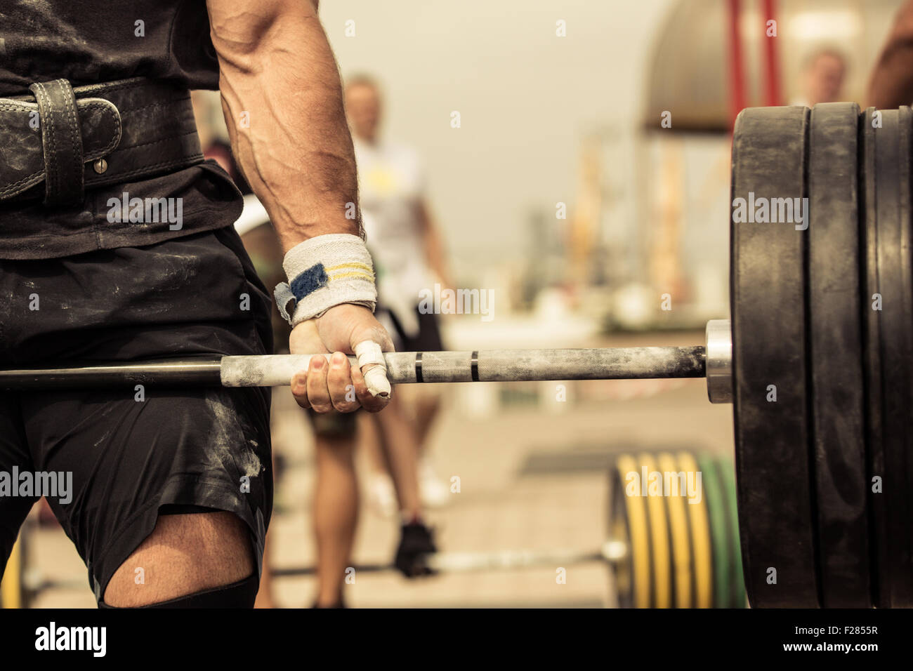 Closeup portrait of professional bodybuilder workout with barbell outdoors - Stock Image