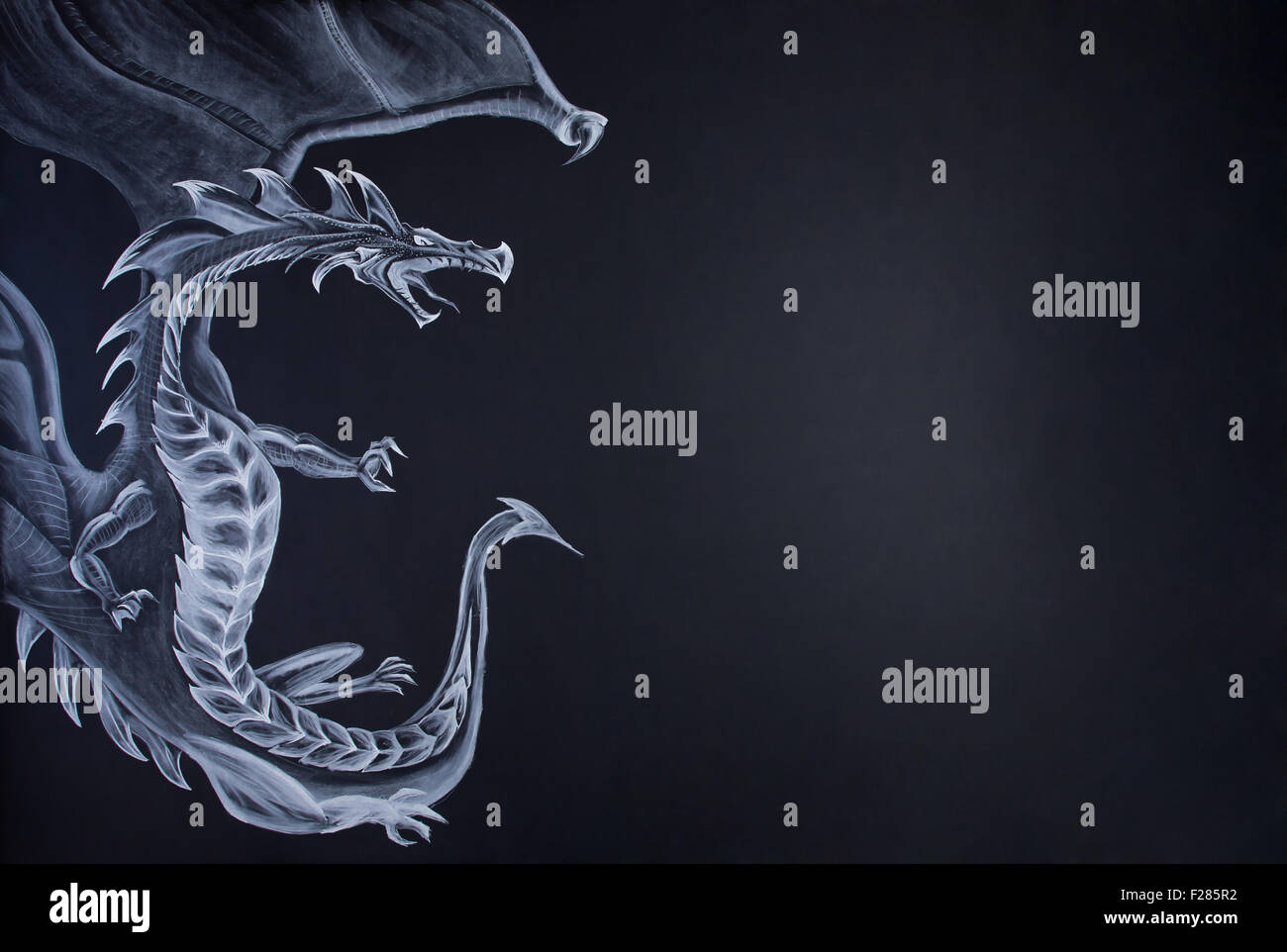 Farytale dragon draw with chalk on paper. Large copy space on right. - Stock Image