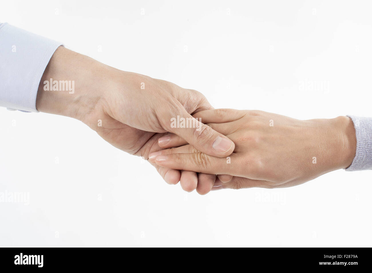 Close-up of man holding woman's hand, Bavaria, Germany - Stock Image