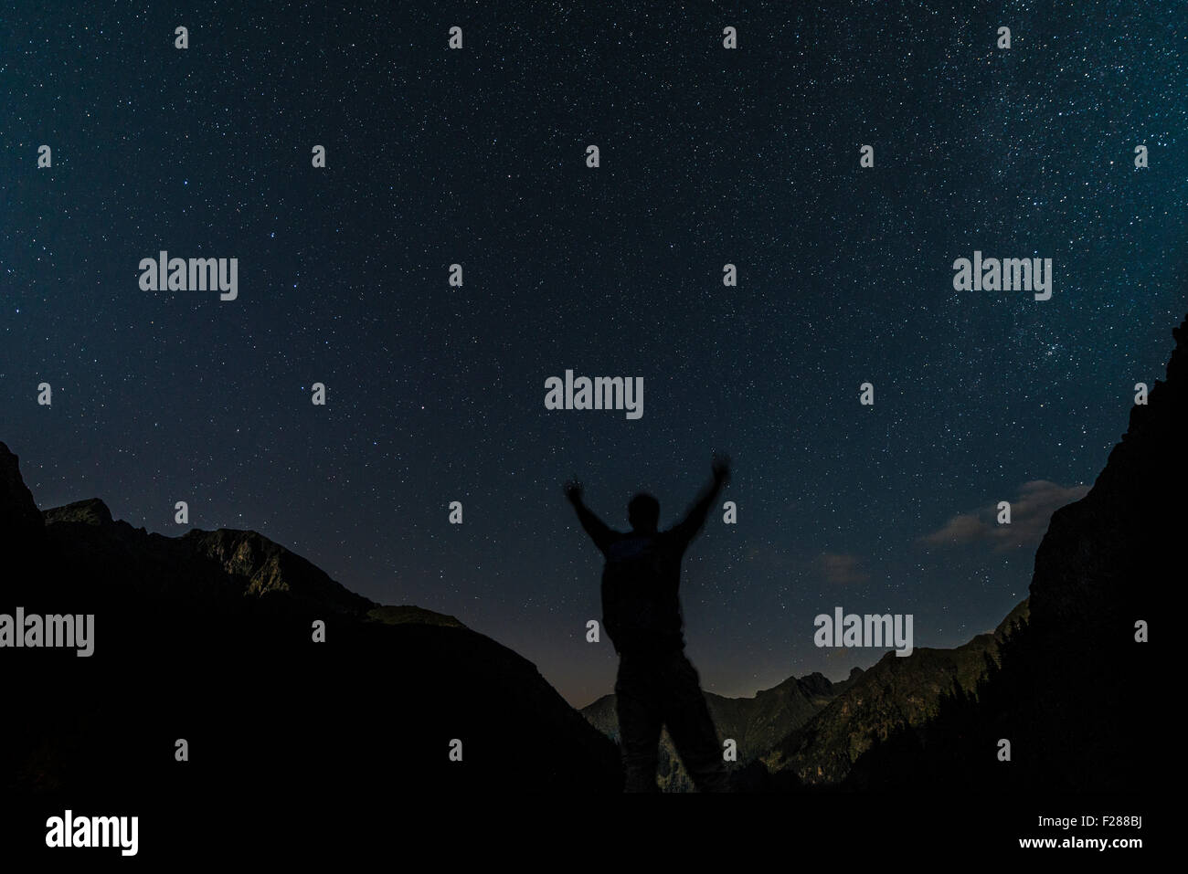 Silhouette of person looking at the stars, starry sky at night, Rohrmoos-Untertal, Schladming Tauern, Alps, Styria, - Stock Image