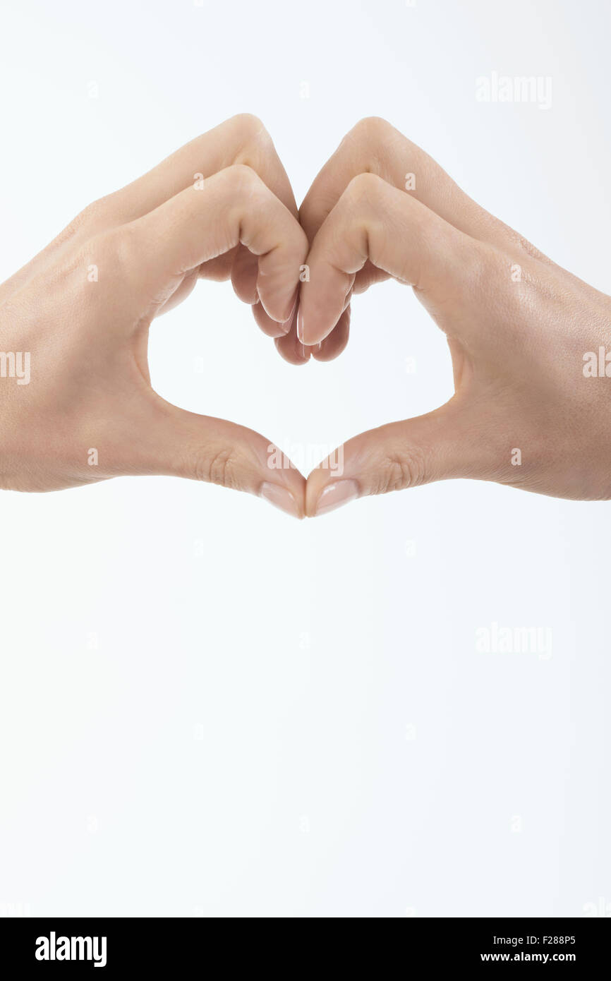 Close-up of woman's hands making heart shape, Bavaria, Germany - Stock Image