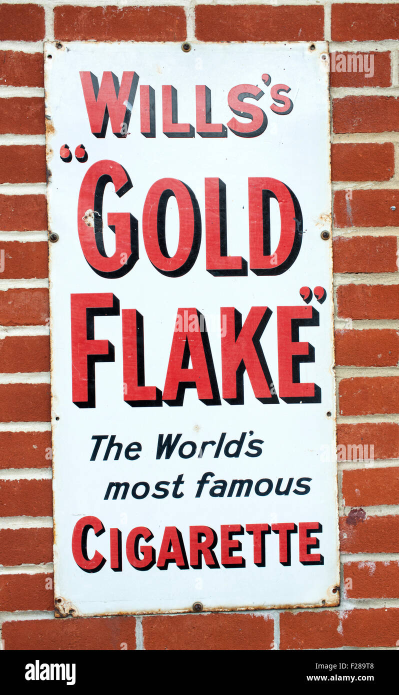 Wills's Gold Flake vintage metal advertisement sign. - Stock Image