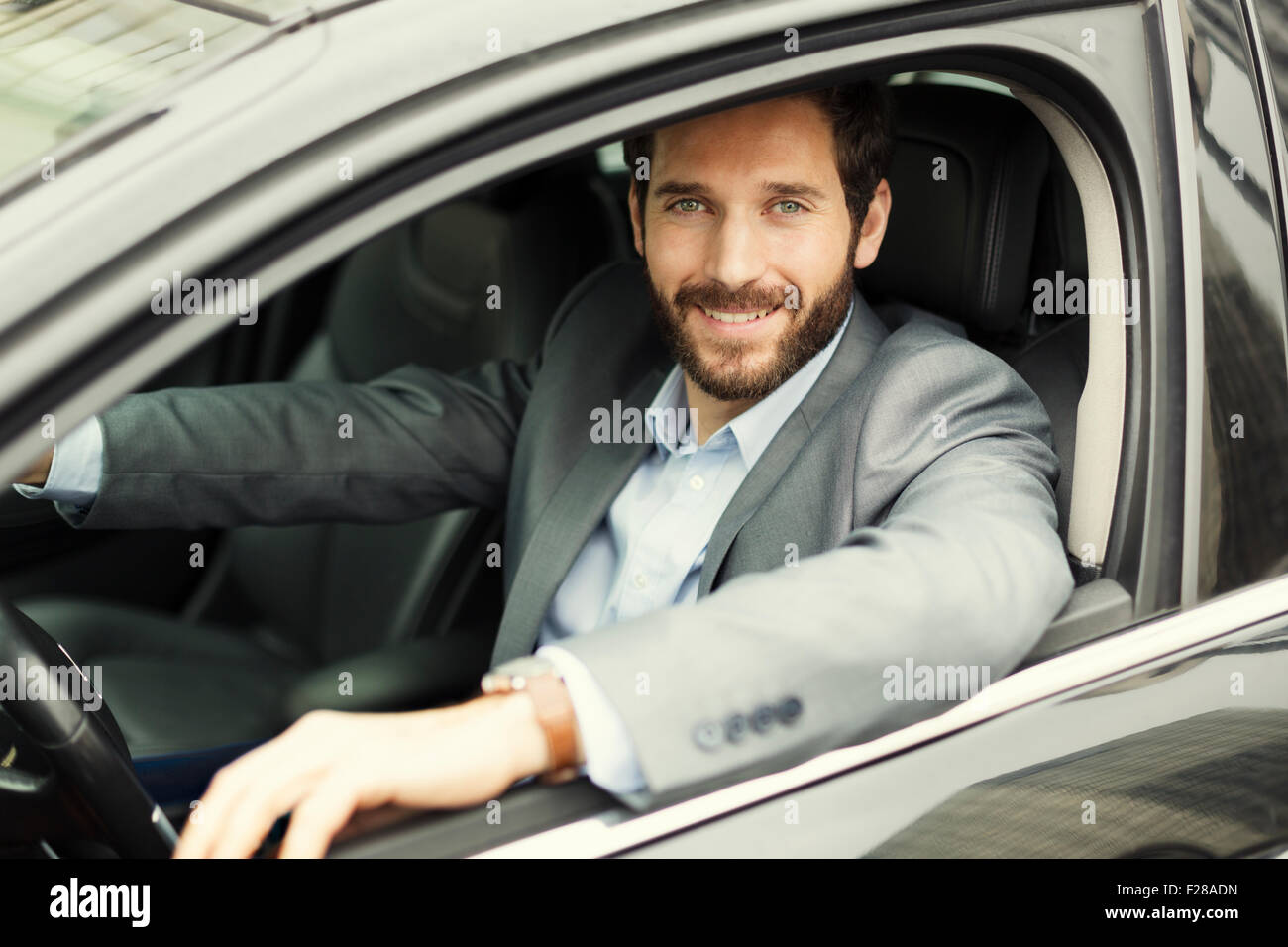 Portrait of man in his car. looking camera Stock Photo