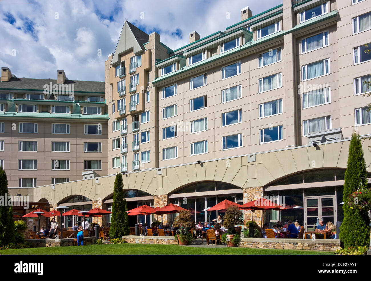 Exterior of the Fairmont Chateau Whistler hotel with outdoor patio in the summer of 2015.  In Upper Village (Blackcomb) Stock Photo