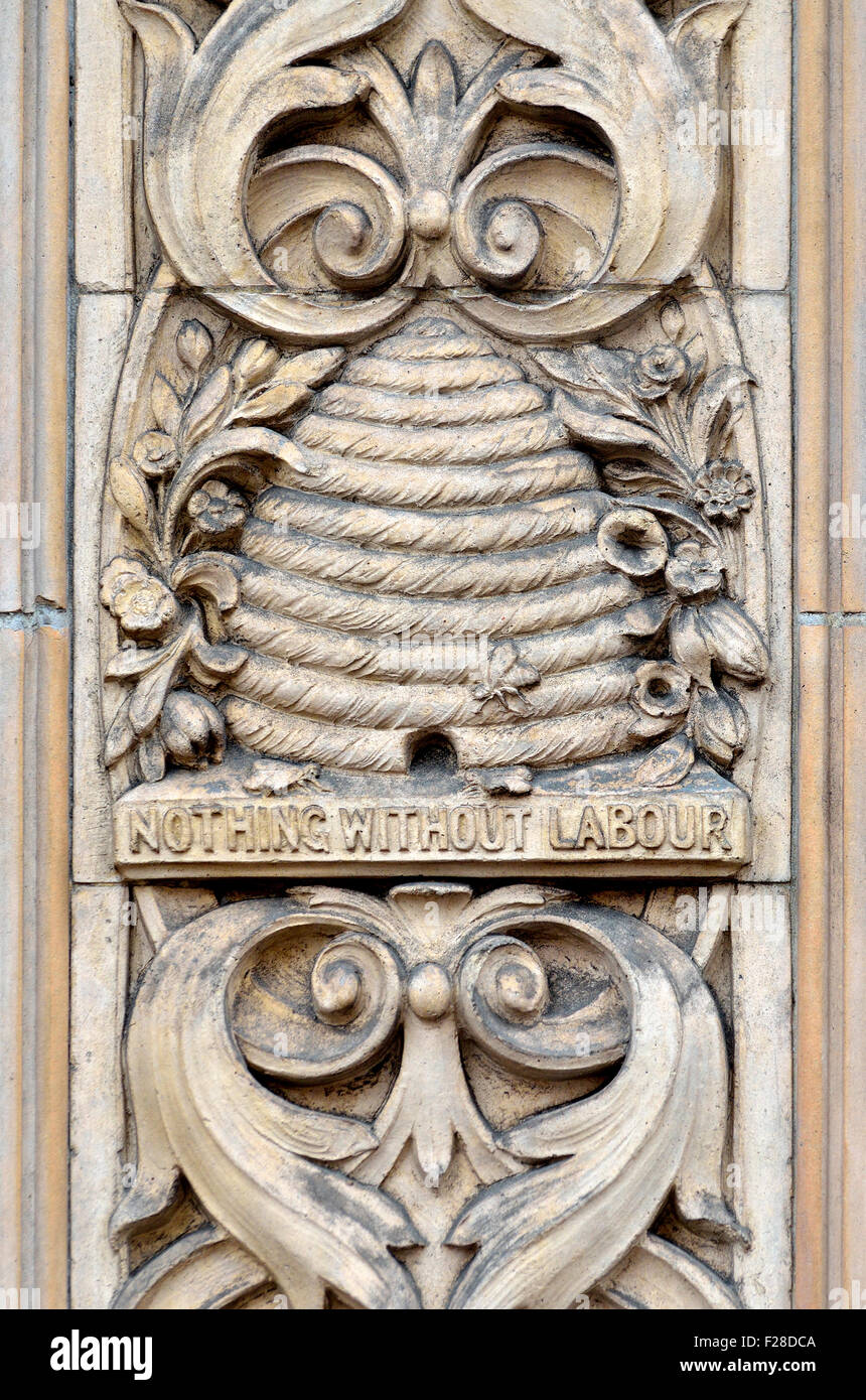 London, England, UK. Carved detail of beehive and 'Nothing Without Labour' on an external wall of Duchy - Stock Image
