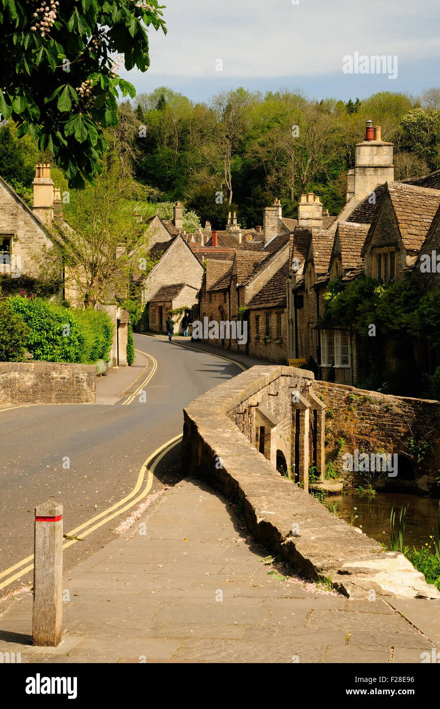Picturesque cottages and bridge over the By Brook in the village of Castle Combe. - Stock Image