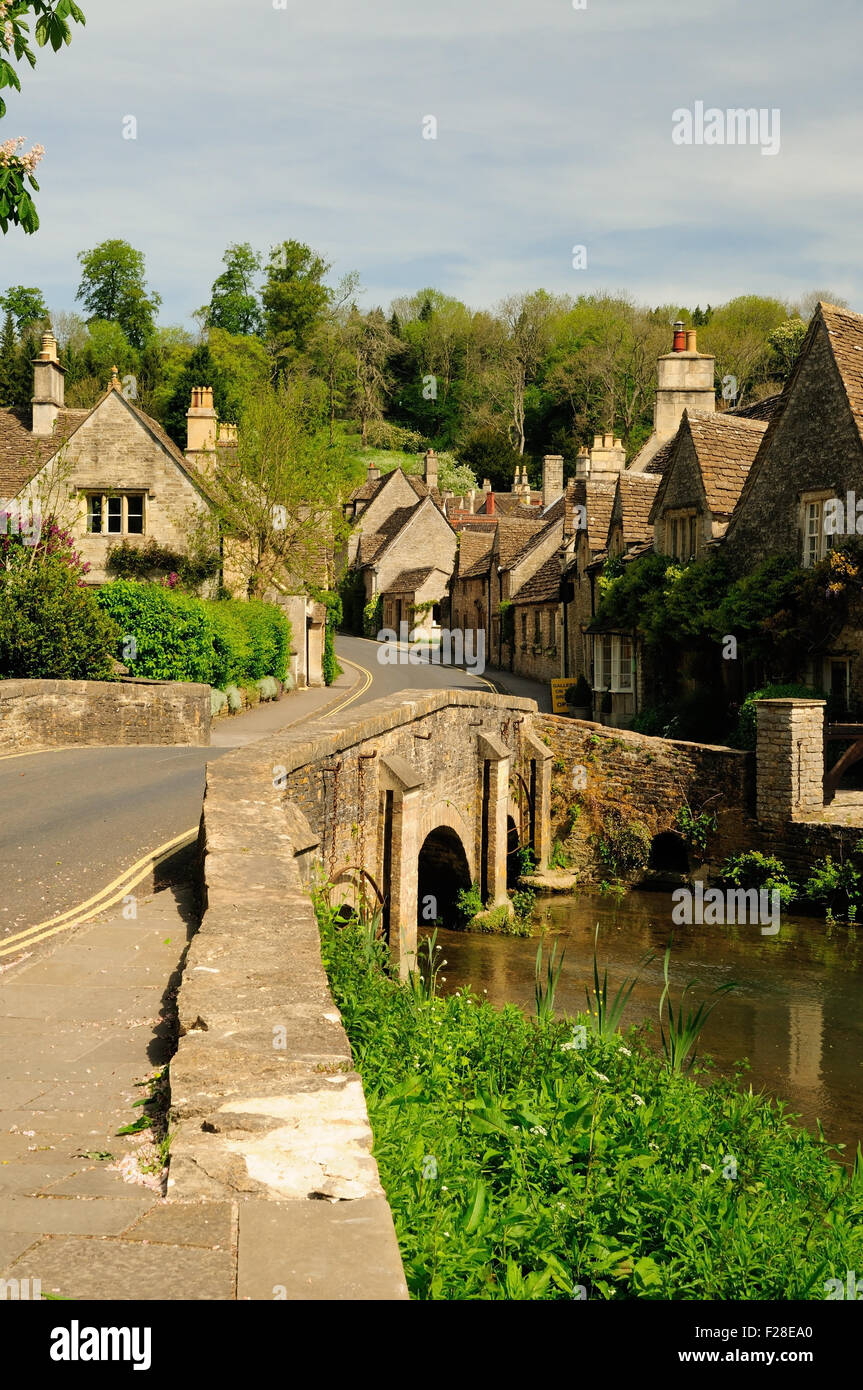 Picturesque cottages beside the bridge over the By Brook in the village of Castle Combe. - Stock Image