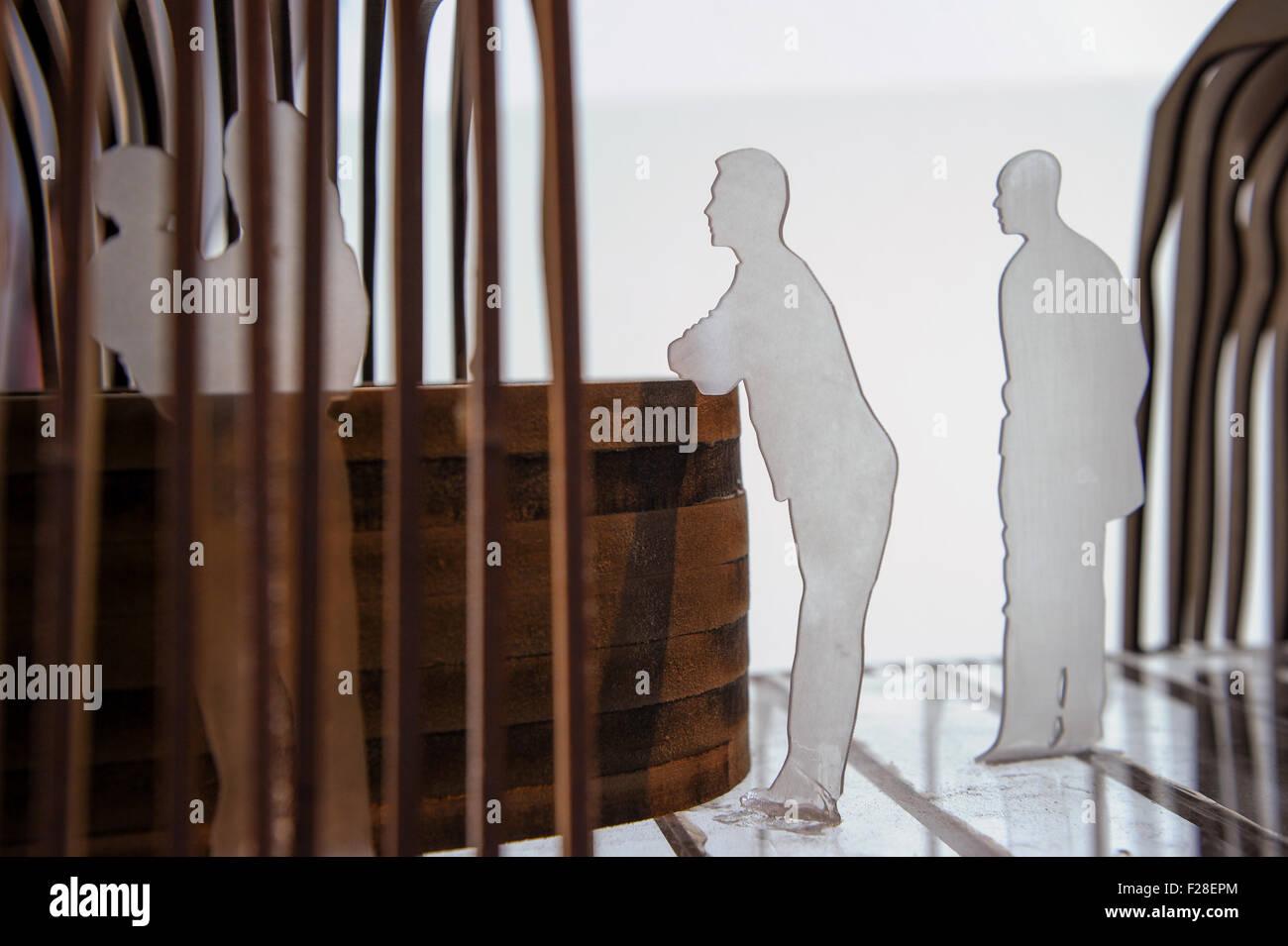 models of men waiting at a bar - Stock Image