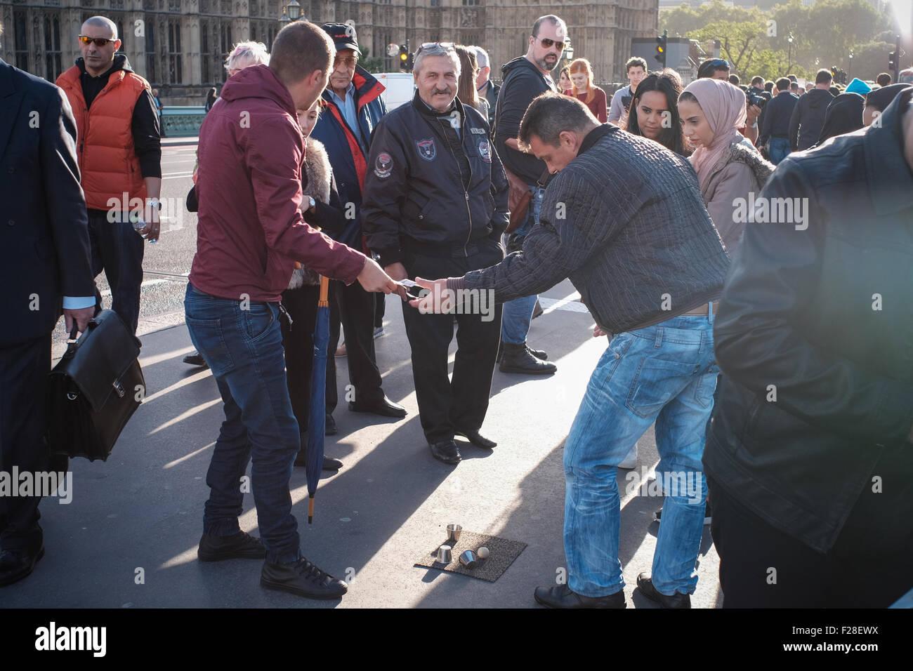 Street gamblers on Westminster bridge - Stock Image
