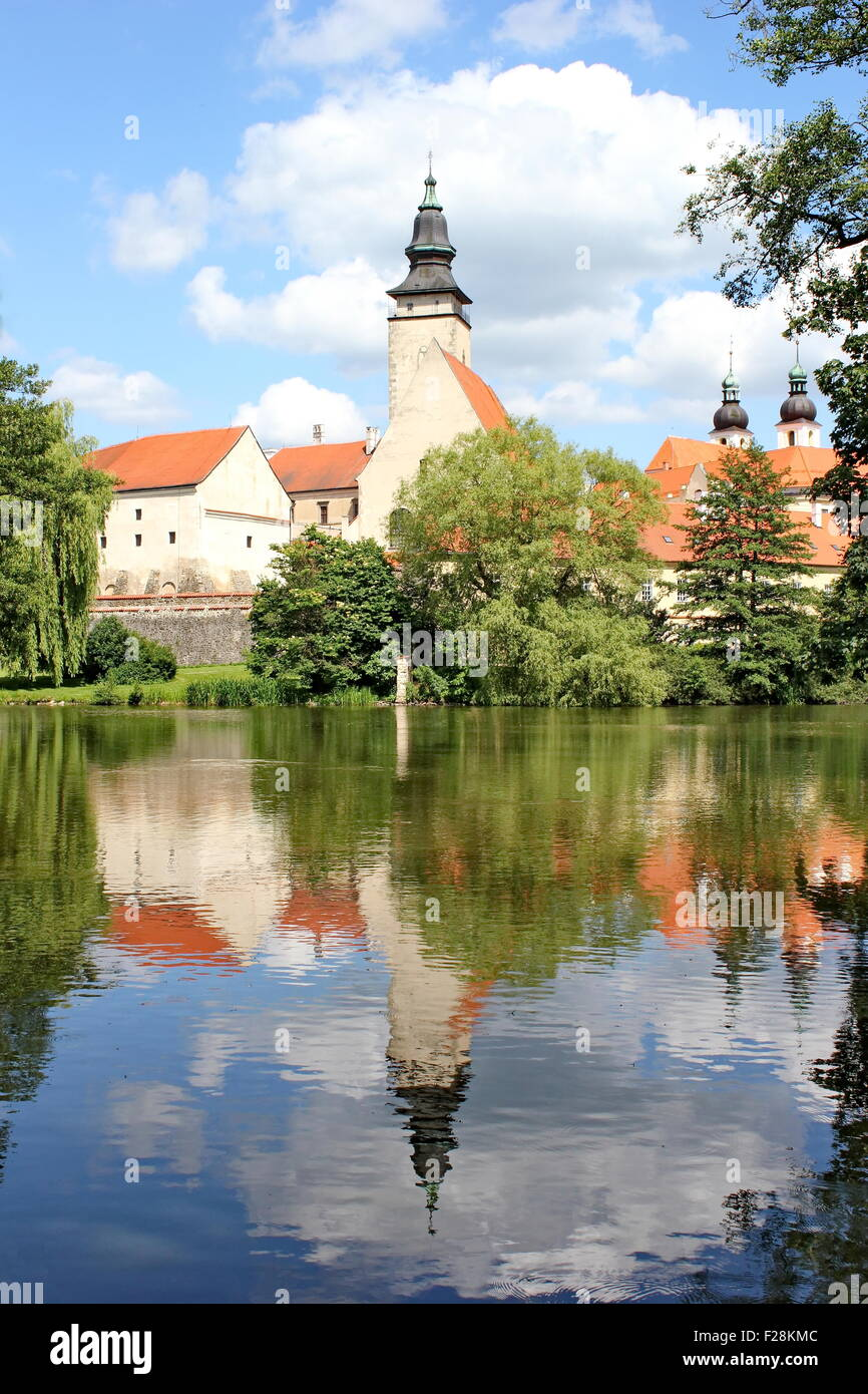 Fairy tale castle and its mirror image on the surface of the pond, Telc, Moravia, Czech republic Stock Photo