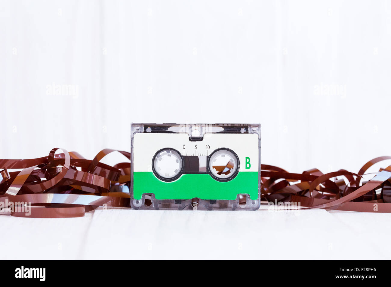 Audio cassette with subtracted out tape on wooden background Stock Photo
