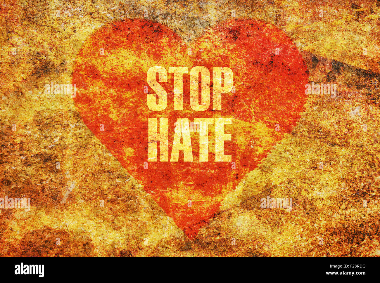 Text Stop Hate written with golden letters on a red heart - Stock Image