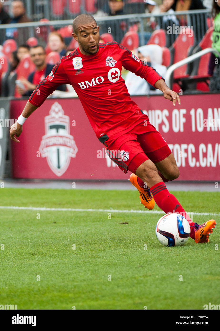 Toronto, Ontario, Canada. 13th September, 2015. Toronto FC defender Justin Morrow  (2) dribbles the ball downfield - Stock Image