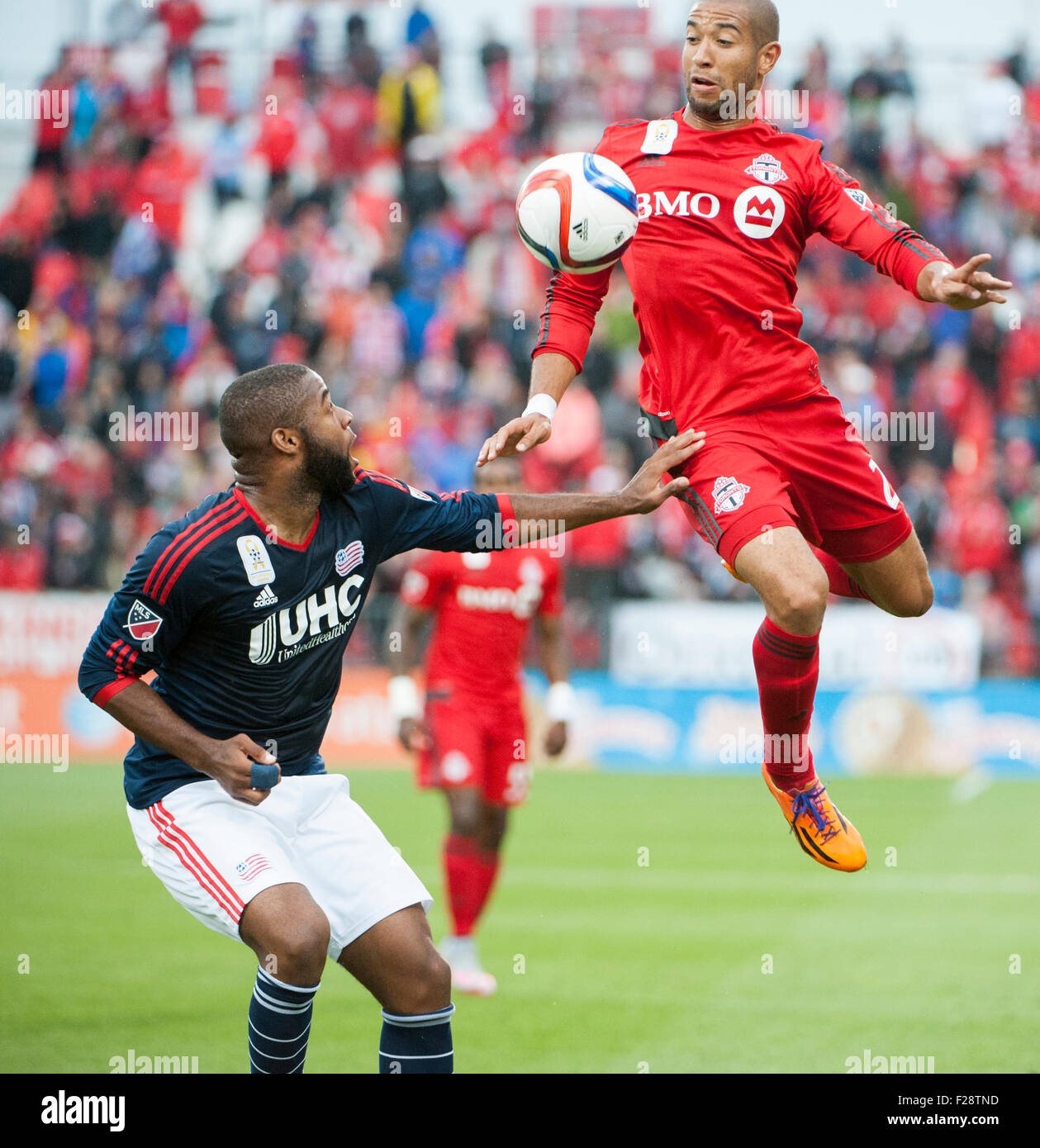 Toronto, Ontario, Canada. 13th September, 2015. Toronto FC defender Justin Morrow  (2) jumps to control the ball - Stock Image