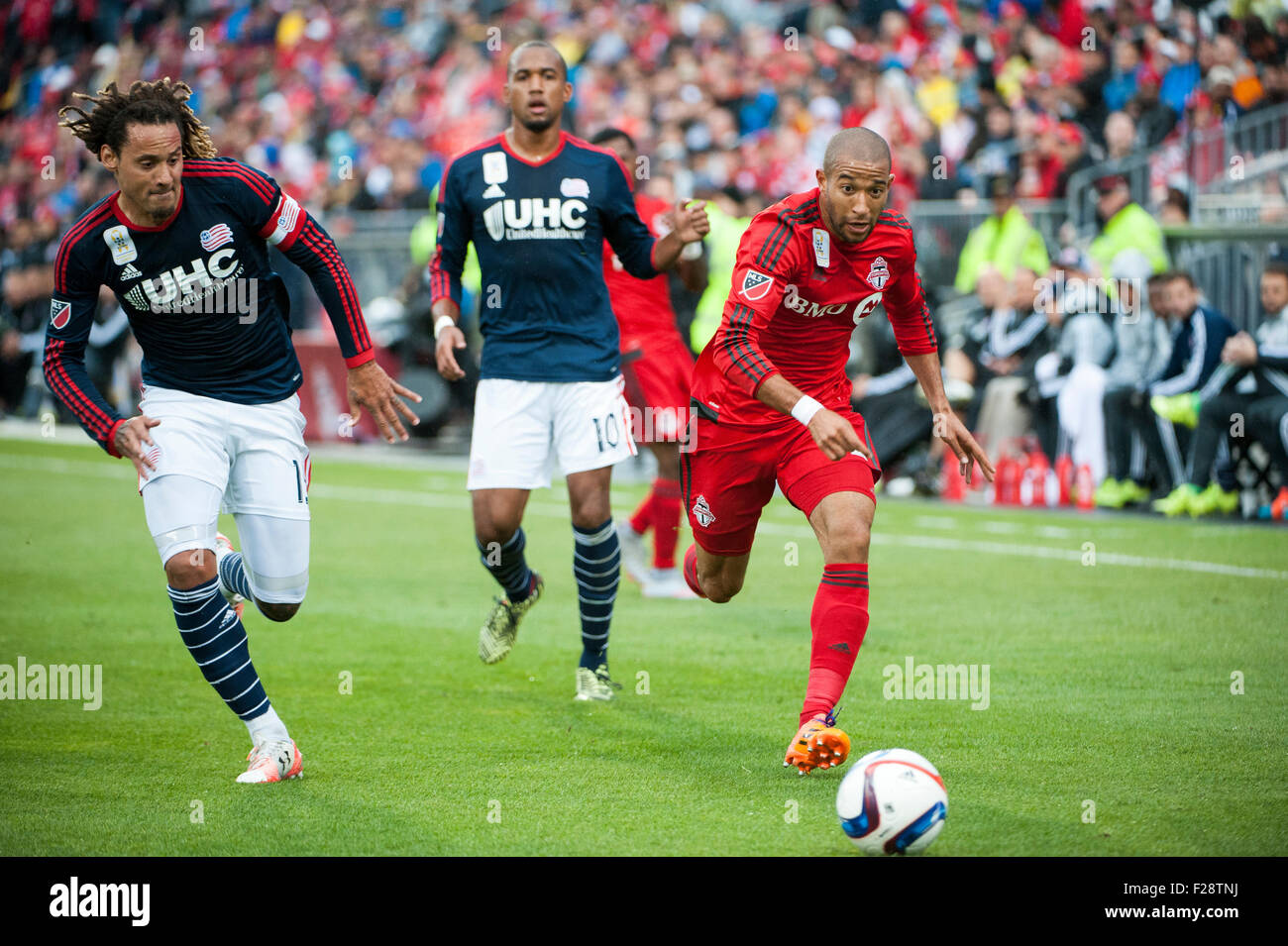 Toronto, Ontario, Canada. 13th September, 2015. Toronto FC defender Justin Morrow  (2) moves past New England Revolution - Stock Image