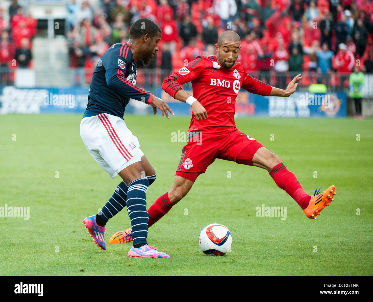 Toronto, Ontario, Canada. 13th September, 2015. Toronto FC defender Justin Morrow  (2) moves to block New England - Stock Image
