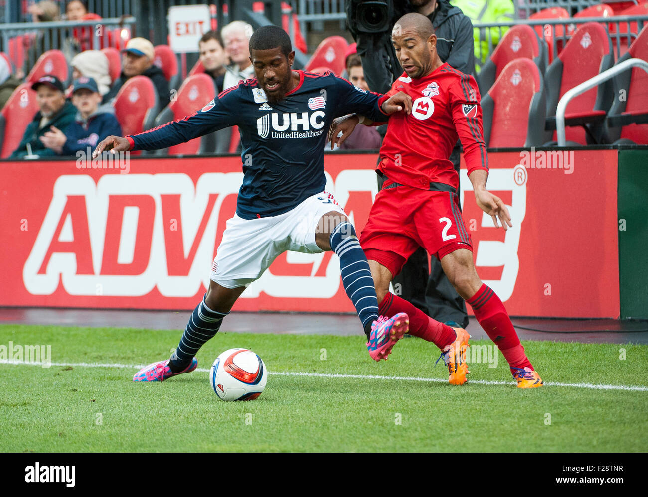 Toronto, Ontario, Canada. 13th September, 2015. New England Revolution defender Jeremy Hall (5) shields the ball - Stock Image