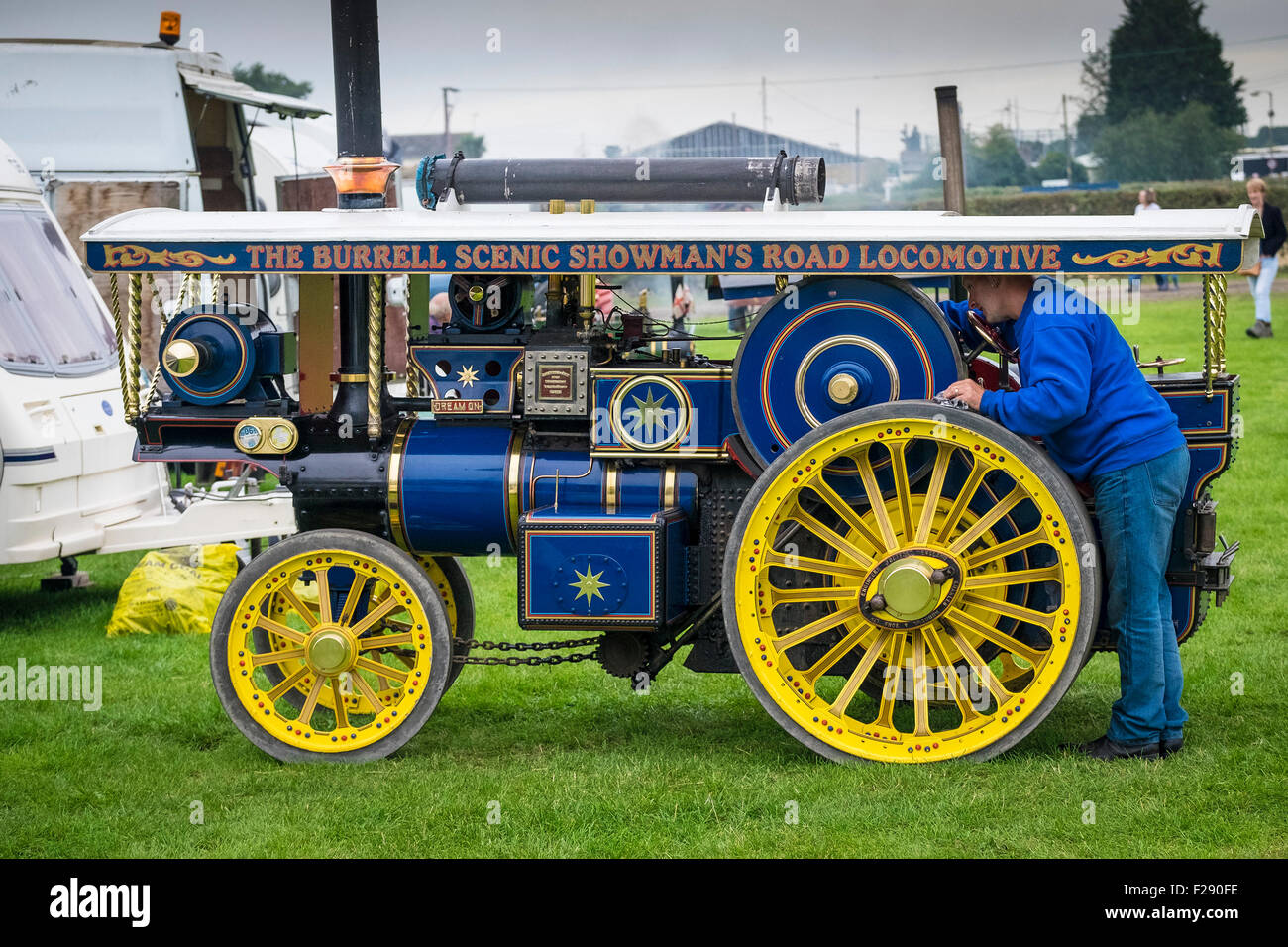 A man carrying out maintenance on his miniature steam engine at the Essex Country Show, Barleylands, Essex. - Stock Image