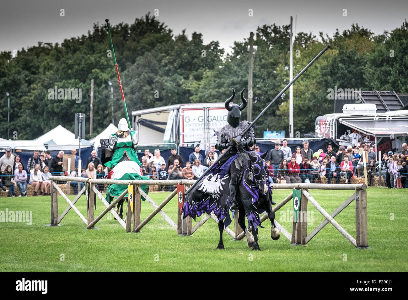 Knights of the Damned jousting in a tournament at the Essex Country Show, Barleylands, Essex. - Stock Image
