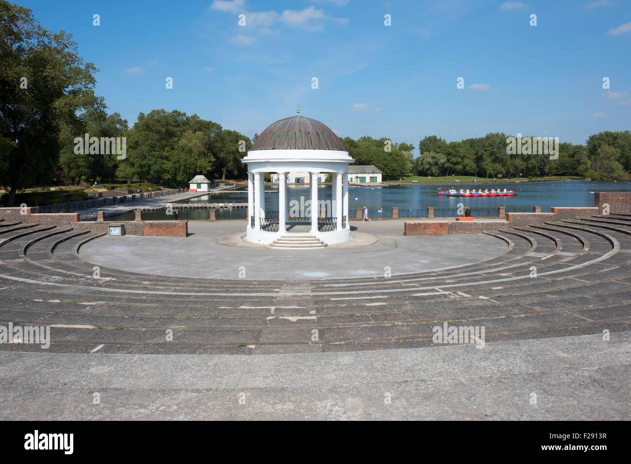 Bandstand and amphitheatre alongside the lake in Stanley Park, Blackpool, Lancashire - Stock Image