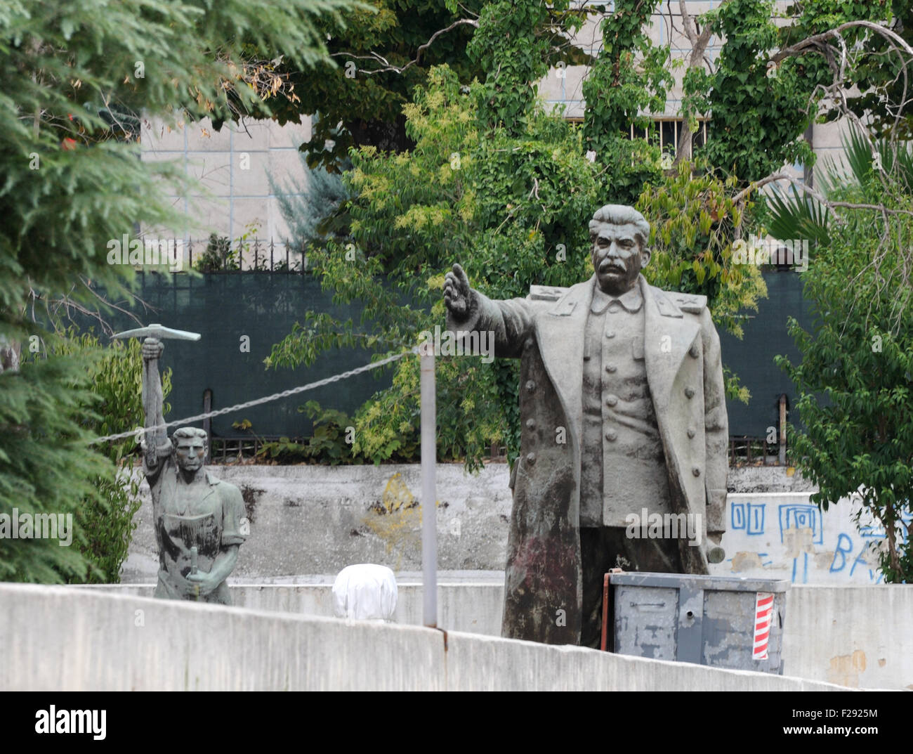 Statues of Joseph Stalin and a worker banished from prominent positions in Tirana to a yard behind the National - Stock Image