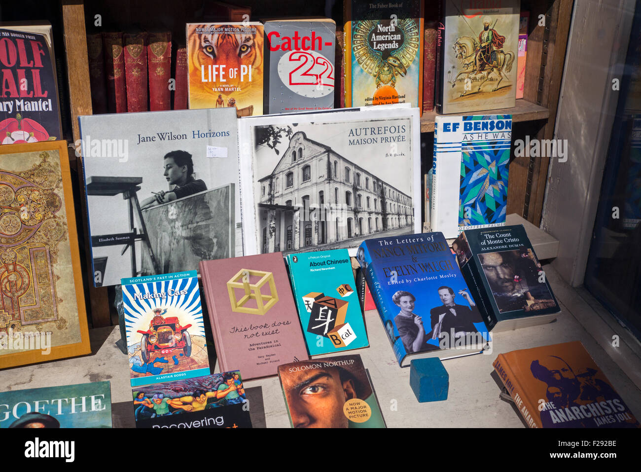 A display of books for sale in the window of a secondhand bookshop, Edinburgh, Scotland. - Stock Image