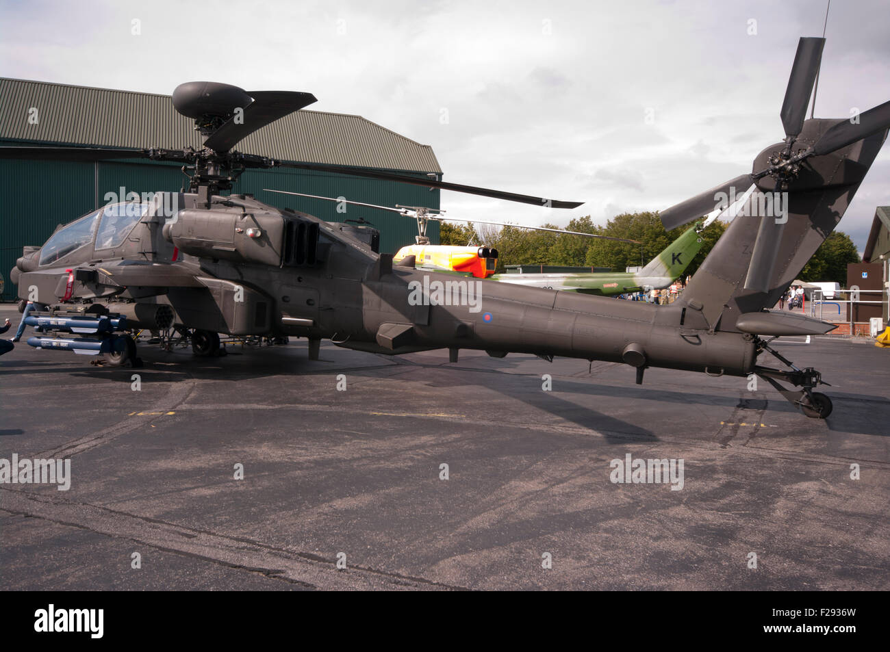 Side view Of A British Army Boeing AH-64 Apache Helicopter - Stock Image