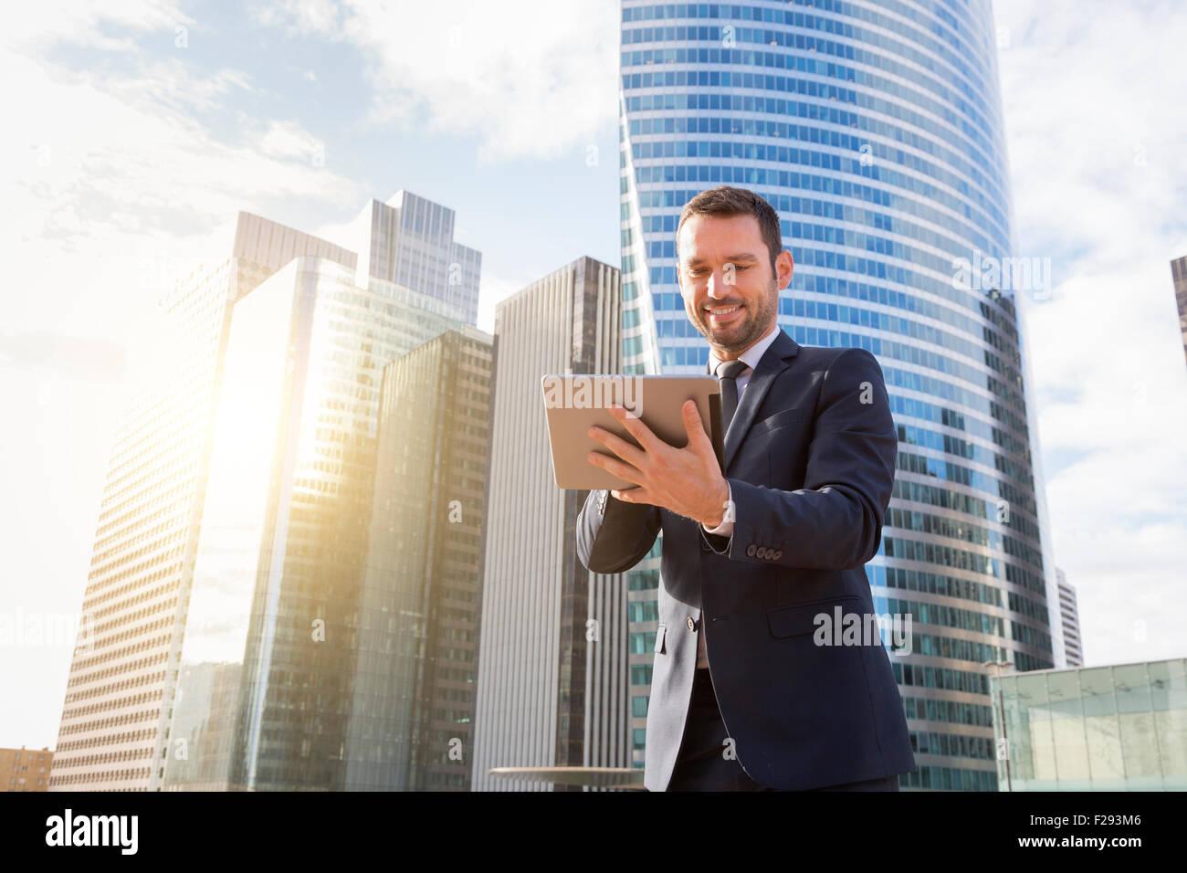 Businessman using a digital tablet - Stock Image