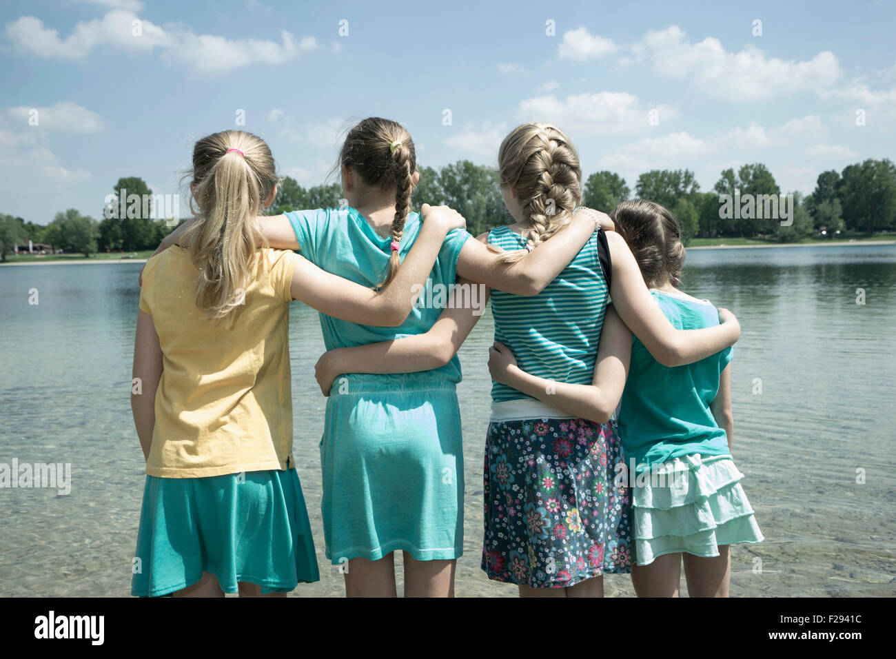 Group of friends standing in the lake, Bavaria, Germany Stock Photo