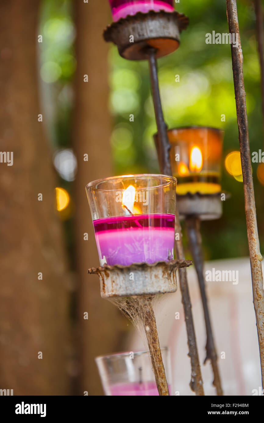 candles in glass candle holders - Stock Image