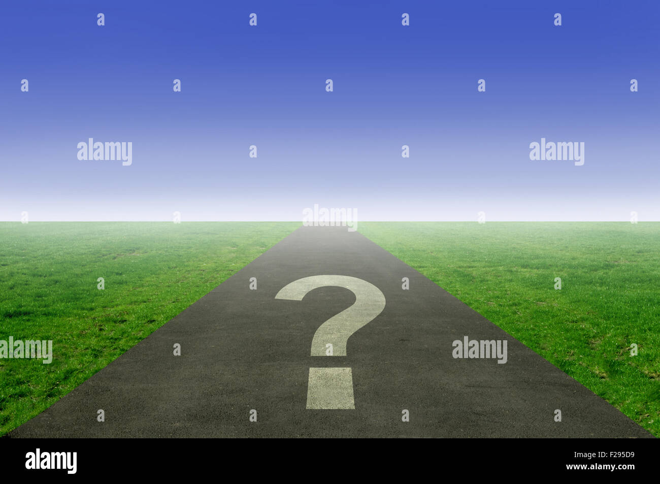 Question mark printed on an open road leading out to the horizon - Stock Image