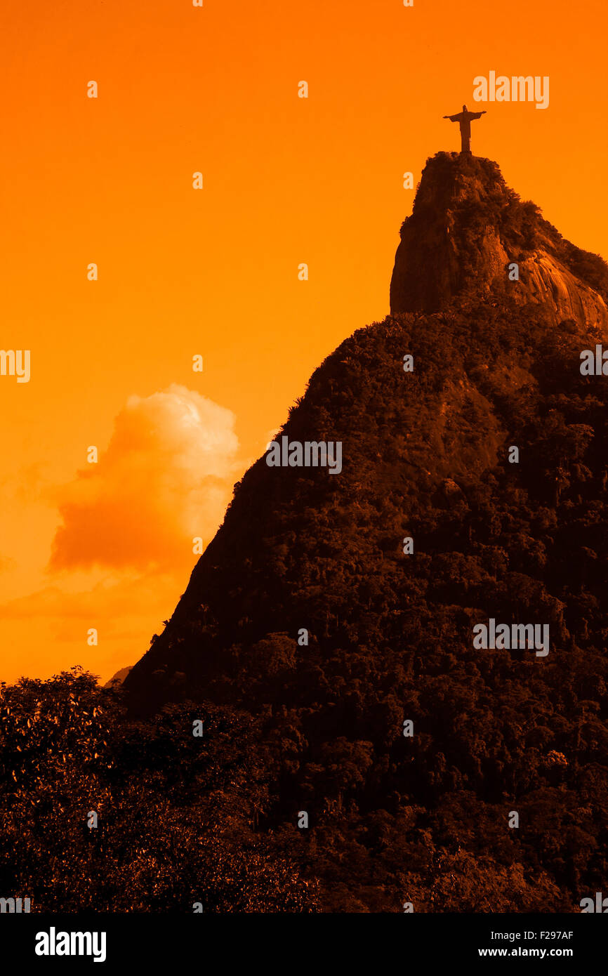 Scenic view of Christ the Redeemer statue and Corcovado mountain at sunset, Rio de Janeiro, Brazil. Stock Photo