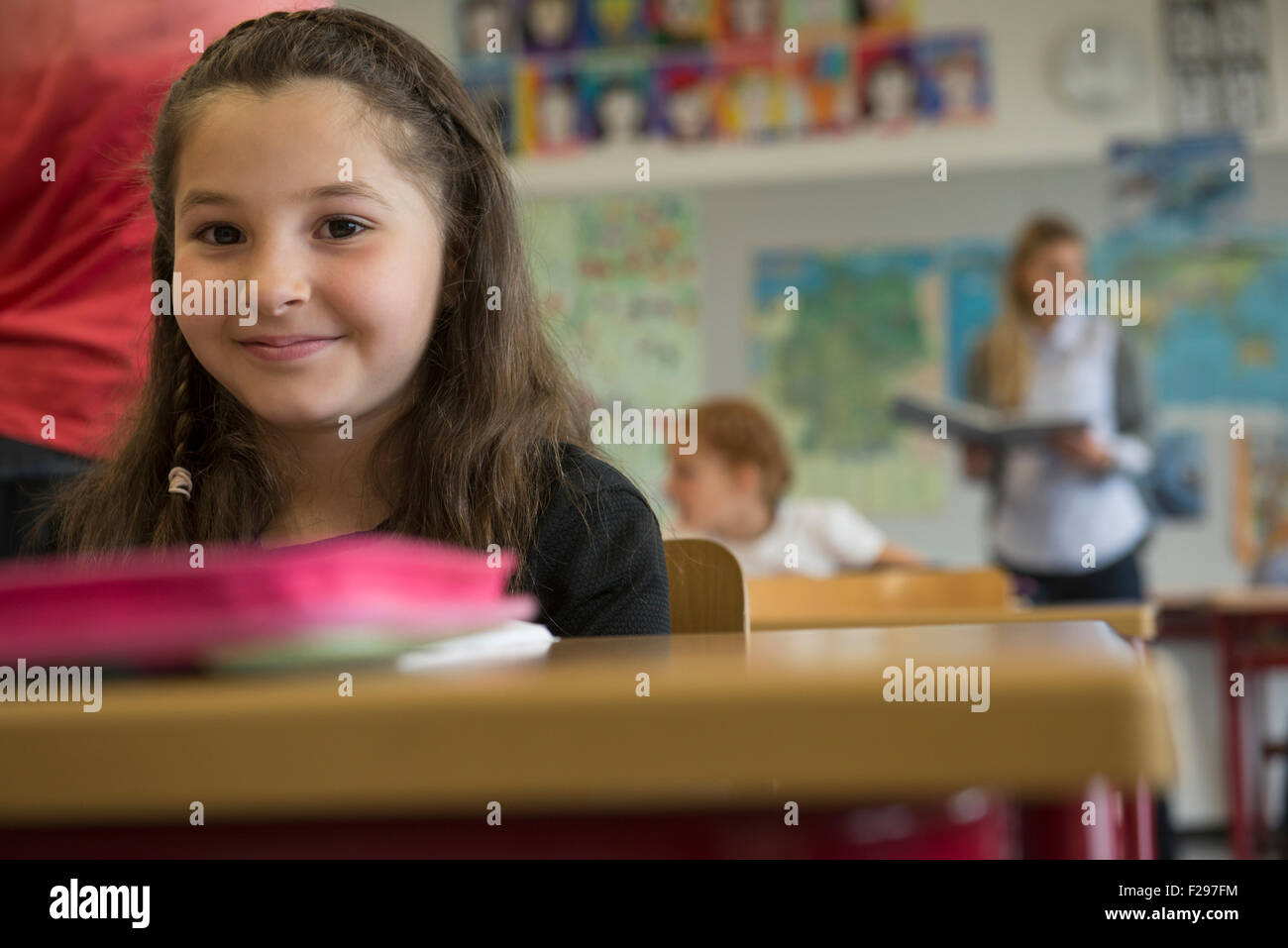 Portrait of a schoolgirl in classroom, Munich, Bavaria, Germany - Stock Image