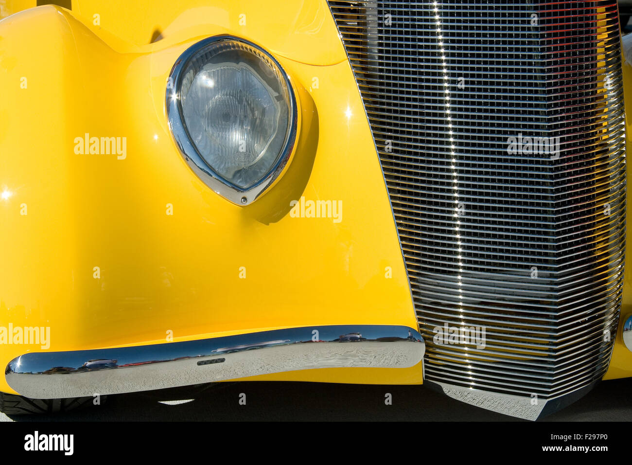 Old and stylish yellow collectible ancient car - Stock Image