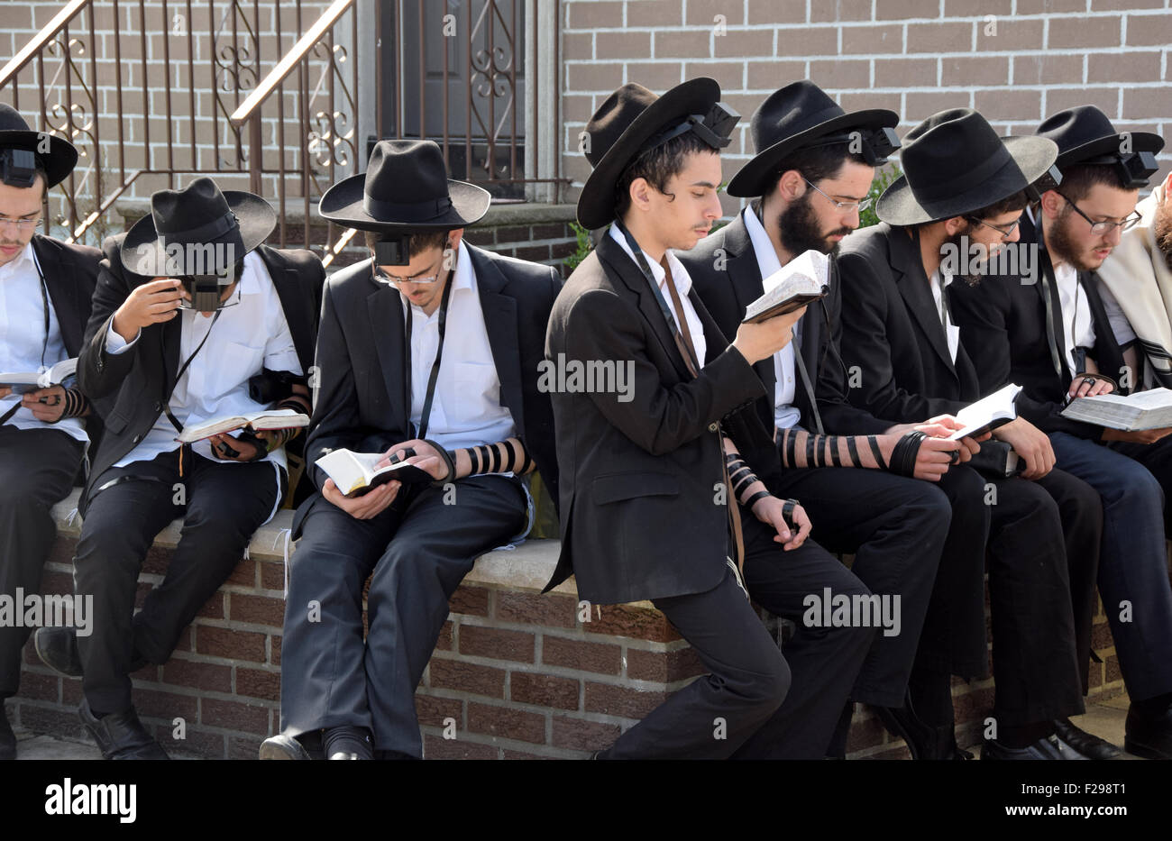 On the day before Jewish New Years religious  boys pray outdoors at the Lubavitcher Rebbe's gravesite in Queens, - Stock Image