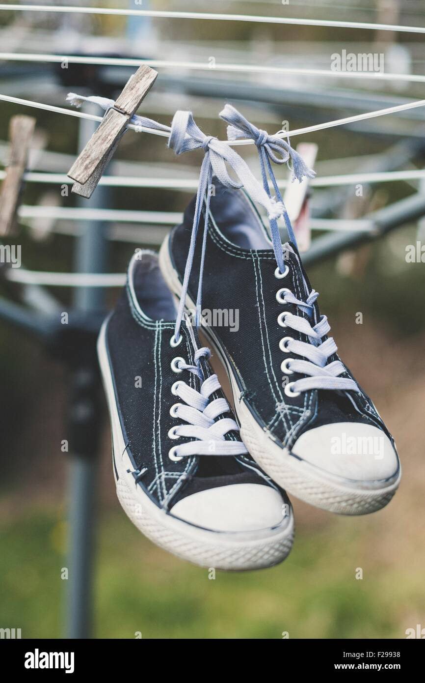 Canvas shoes on the washing line to dry - Stock Image