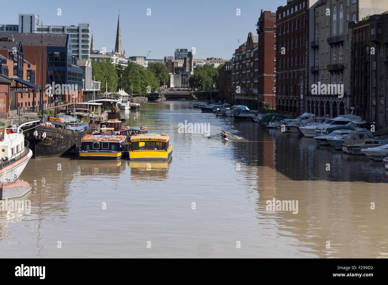 View of Bristol docks looking towards Bristol Bridge showing riverside warehouses - Stock Image