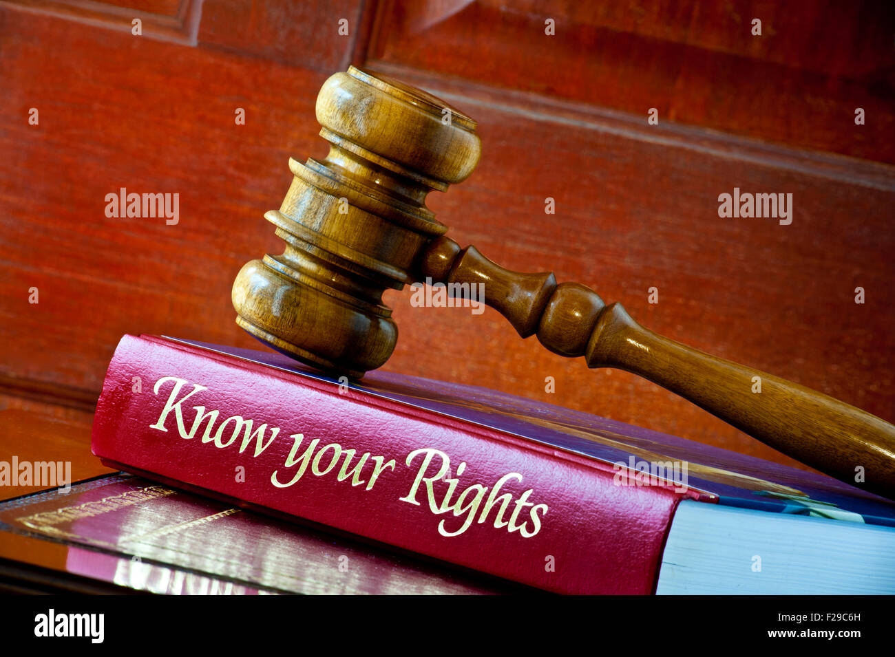 Legal concept of Judges wooden gavel on 'Know your Rights' personal consumer legal advice book on leather - Stock Image