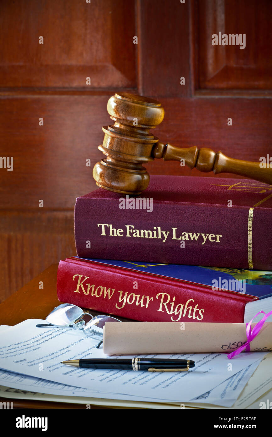 Legal concept of Judges gavel home reference legal advice books and legal letters and  correspondence on leather - Stock Image