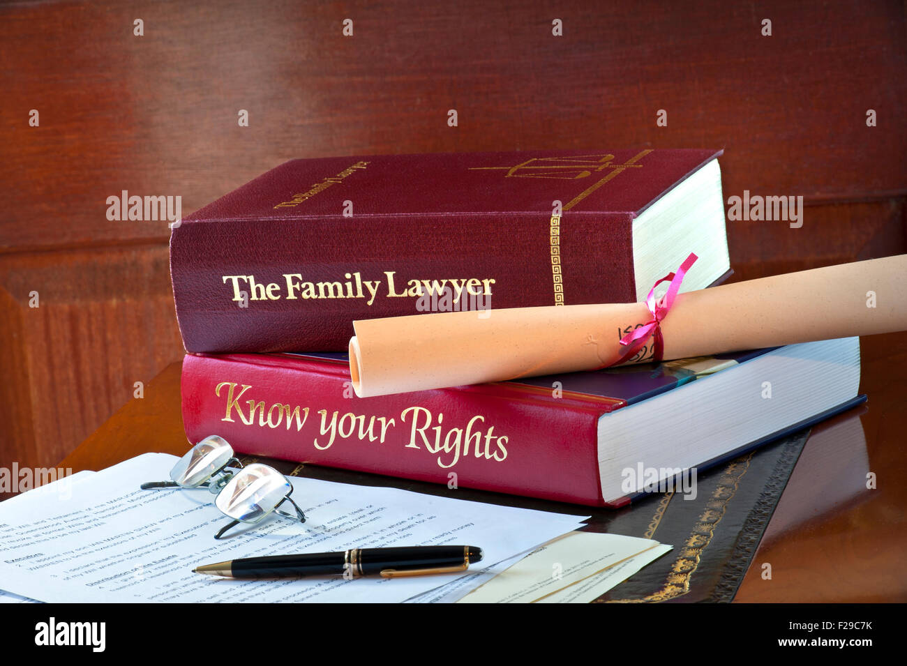 Legal concept of home reference legal advice books and legal letters and  correspondence on leather bound desk - Stock Image
