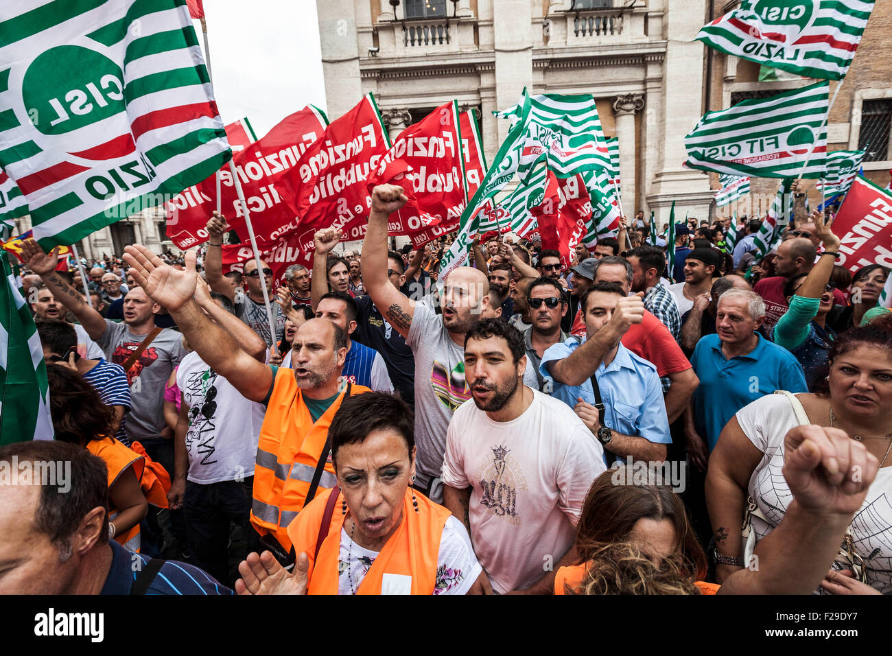 Rome, Italy. 14th Sep, 2015. AMA's employees wave union flags as they take part in a demonstration to protest against Stock Photo