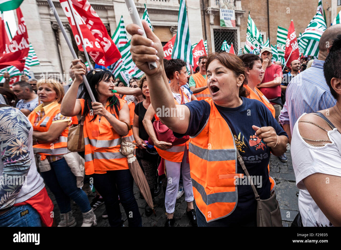 Rome, Italy. 14th Sep, 2015. AMA's employees shout slogans as they take part in a demonstration to protest against Stock Photo