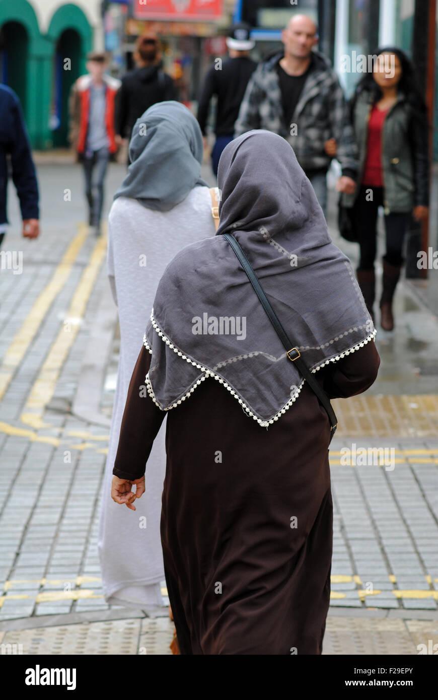 Two Muslim women wearing hijab in England UK - Stock Image