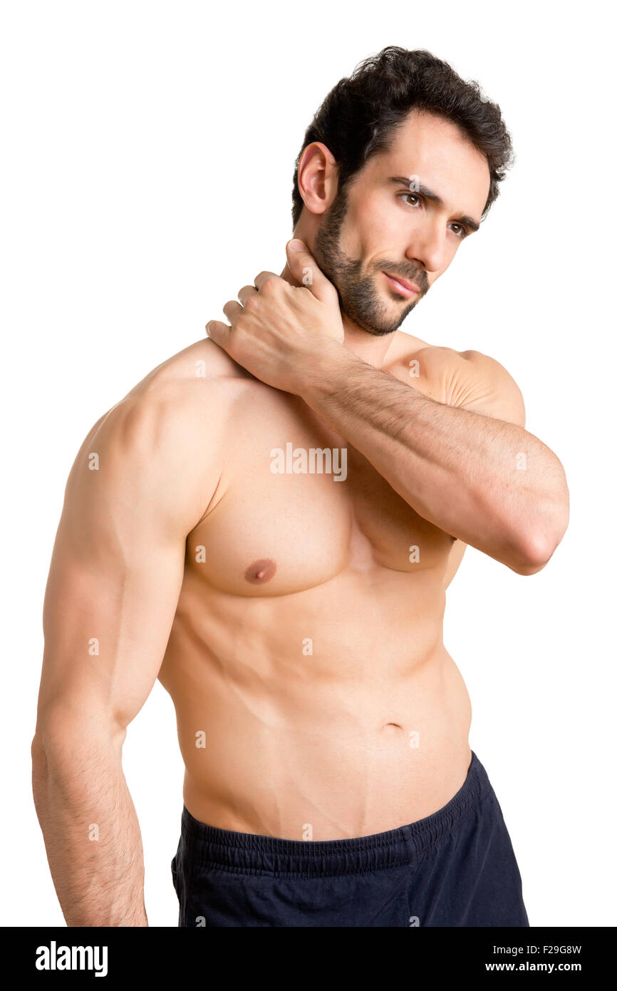 Athlete suffering from neck pain isolated in white - Stock Image