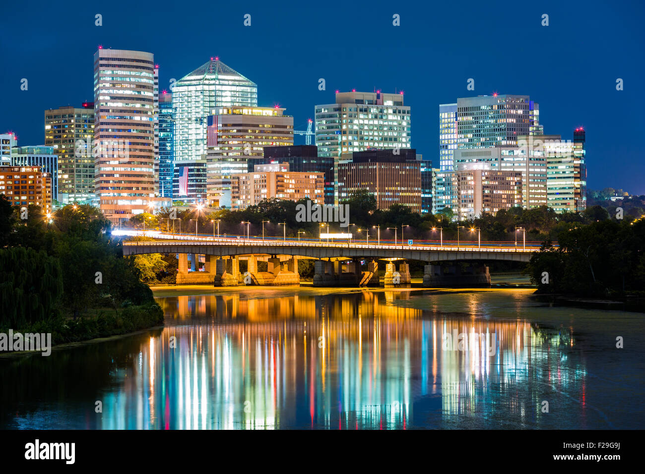 Rosslyn district skyline connected to Washington DC through Theodore Roosevelt memorial bridge. - Stock Image