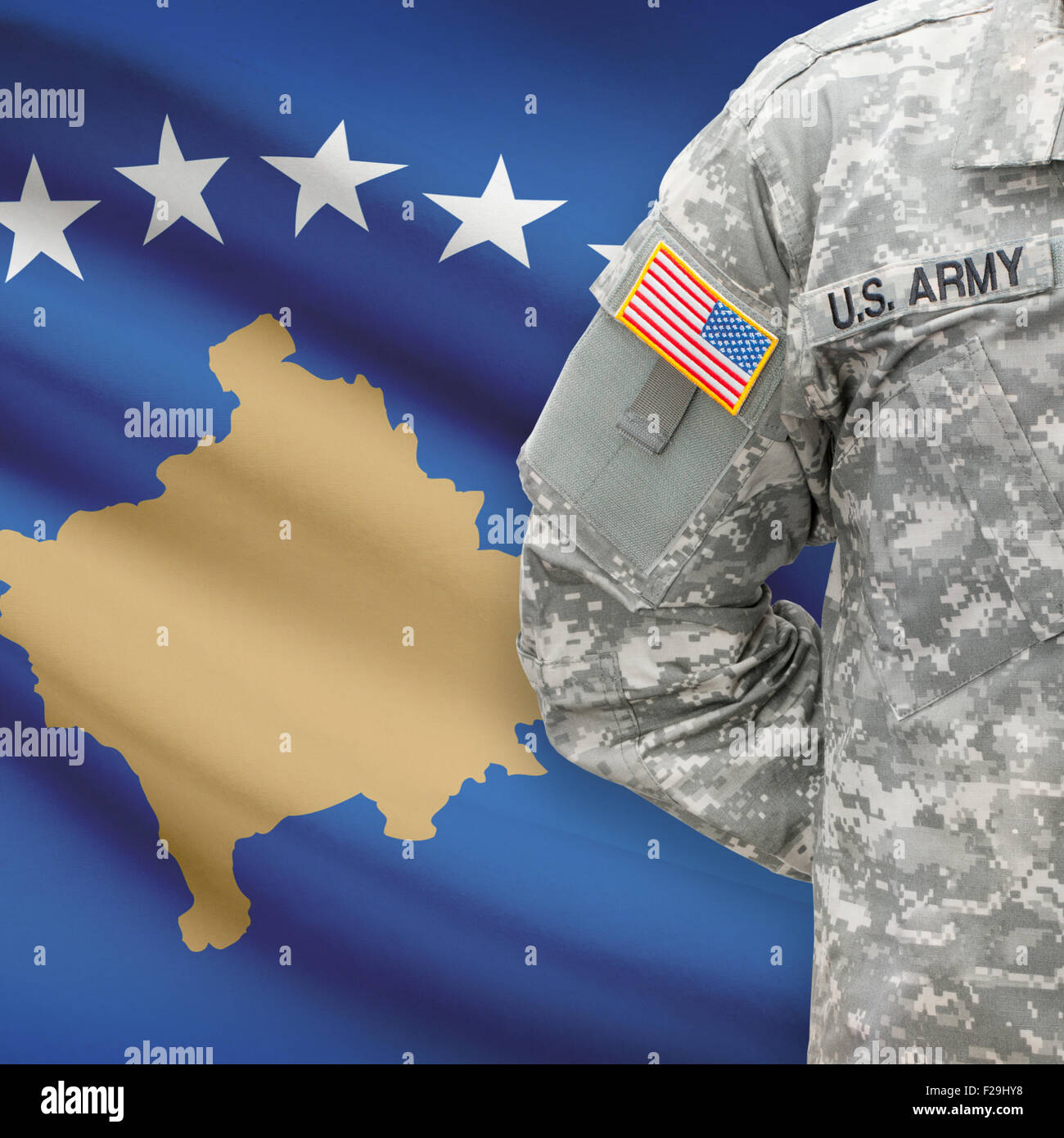 American soldier with flag on background series - Kosovo Stock Photo