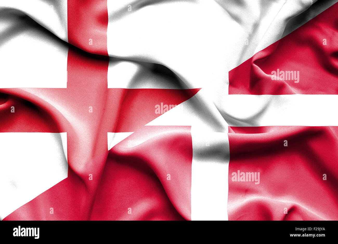 Waving flag of Denmark and England Stock Photo