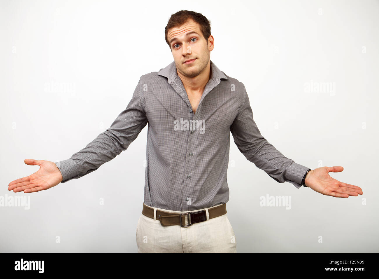Mistake or sorry concept - confused young man looking innocent - Stock Image