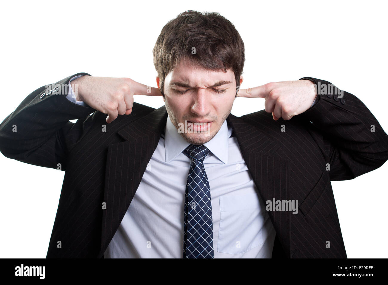 Isolated businessman expressing stress and noise concept - Stock Image