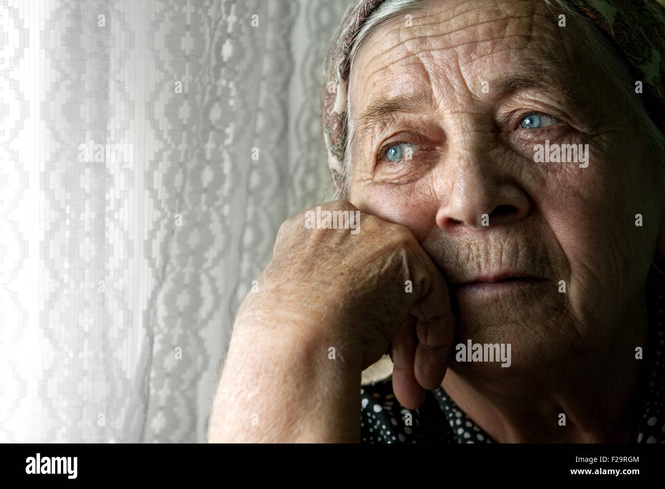 Elder senior woman with sad face suffering from depression - Stock Image